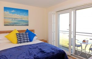 Master bedroom with sea views in serviced apartment in Sovereign Harbour