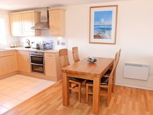Dining area of this serviced apartment in Sovereign Harbour