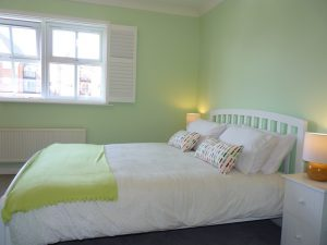 Bedroom in this short stay accommodation for families