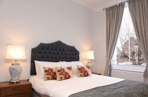 Example bedroom of serviced apartments Eastbourne