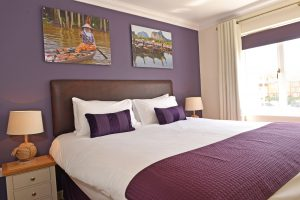 Master bedroom of this serviced flat