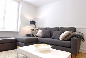Comfy sofa in this short term apartment